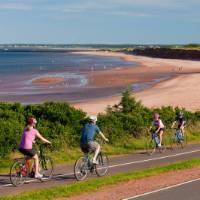 Cycling along the coast in Prince Edward Island National Park | Tourism PEI / John Sylvester